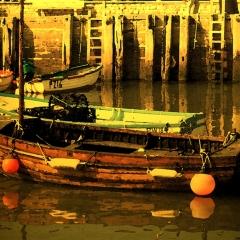 Boats West Bay evening sun